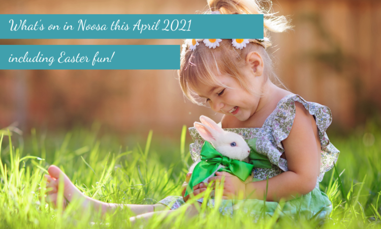 young girl sitting on grass holding bunny